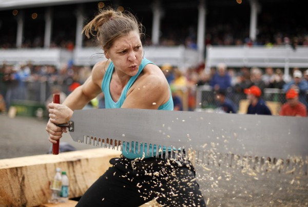Julie Miller of Branchport, N.Y., muscles through a 10-inch log during the crosscut saw competition at the Woodman's Field Day at the Fryeburg Fair.