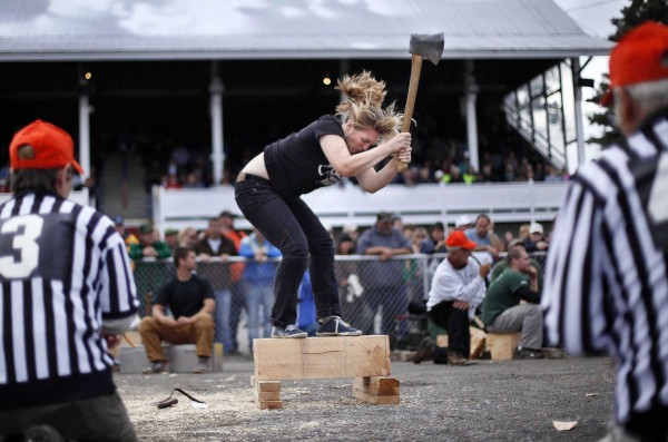Allison Melton of Bangor swings in the underhand chop competition during the Woodman's Field Day at the Fryeburg Fair. Melton is a fine arts graduate student at the University of Maine at Orono.