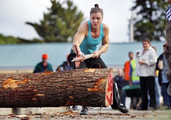 Julie Miller of Branchport, N.Y., competes in the log rolling contest during the Woodman's Field Day at the Fryeburg Fair.
