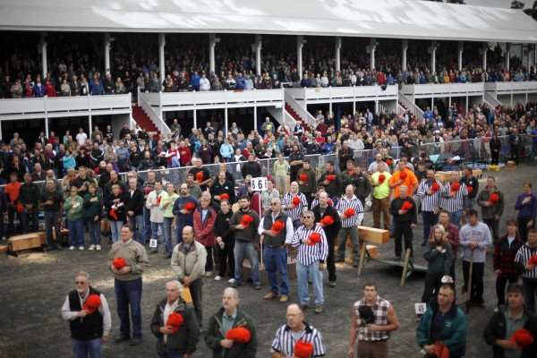 More than 6,000 spectators and 193 competitors stand at attention during the national anthem to begin the 44th annual Woodman's Field Day at the Fryeburg Fair.