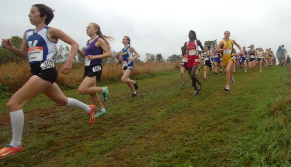 Eventual winner Abbey Leonardi (left) of Kennebunk led from the start of the girls seeded section race of the Maine Cross Counry Festival of Champions in Belfast Saturday, Oct. 1, 2011.