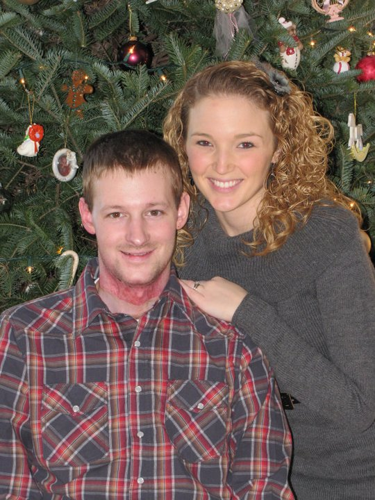 Zane and Courtney Wetzel pose by their Christmas tree on Dec. 25, 2010,