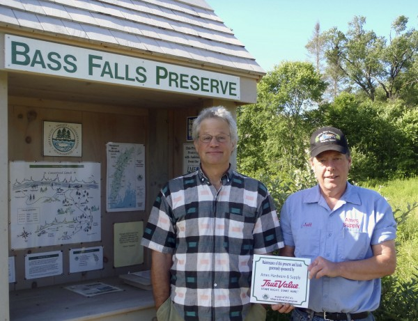 Ames True Value has adopted Sheepscot Valley Conservation Association's Bass Falls Preserve. At the preserve in Alna is volunteer preserve steward Chris Kenoyer (left) and Jeff Averill of Ames True Value Hardware and Supply in Wiscasset.