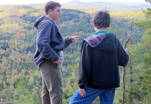 Isaiah Massey, an eighth-grader at Airline Community School in Amherst (left), talks with a schoolmate after hiking to the summit of Bald Bluff Mountain on Thursday.