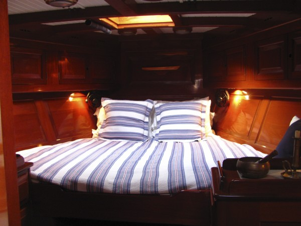 Mahogany paneling lines the entire cabin of the Freesia, including the master stateroom shown here.