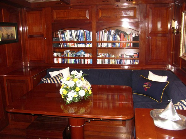 Mahogany paneling lines the entire cabin of the Freesia, including the dining area shown here.