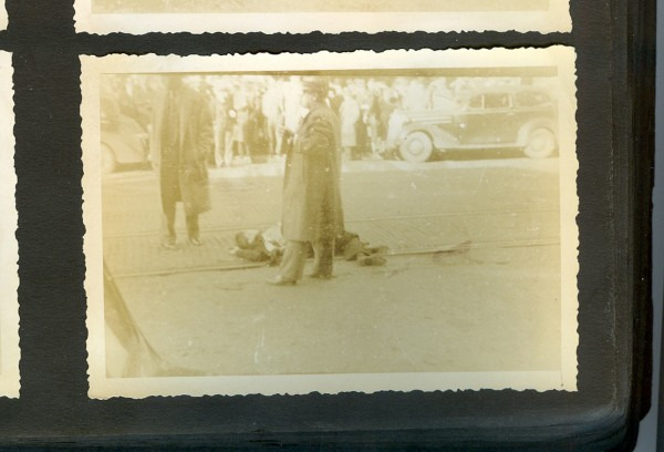 "Two FBI agents stand over the body of Clarence Lee Shaffer Jr. on Central Street in this rare photo taken by the late amateur photographer Rod Speirs. On the morning of Oct 12, 1937, Speirs was driving to his office at the Katahdin Council of the Boy Scouts of America at 25 Broad St. when he heard machine gun fire on Central Street. He ran to the scene and took some of the earliest photos of Shaffer, whose legs were still curled around him, and fellow gangster Al Brady moments after they were shot by FBI agents. Although he claimed to have sold some of the photos to The Associated Press and Bangor Daily News, they have not been seen in years. In a letter written to his parents in his native England, Speirs wrote, ""…This is the first real gang war that I have seen and it had to take place in the little woop woop town of Bangor. …"""