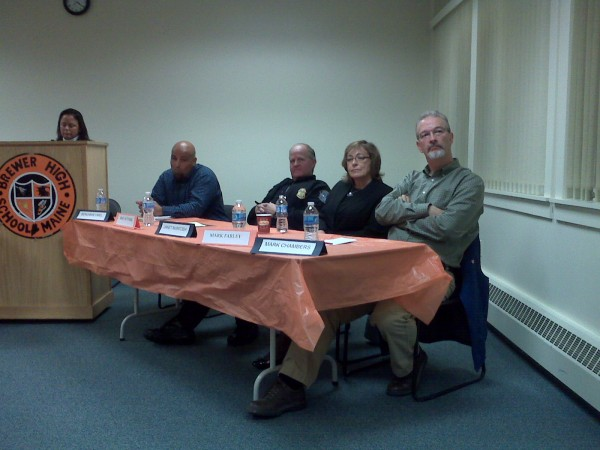 Brewer school board candidates Ben Umel (seated, from left), Michael Hutchins and Janet McIntosh and Brewer High School trustee candidate Mark Chambers listen to a question from the audience at Tuesday night's candidate forum. The Brewer Education Association event was hosted by member Kim Kelley (left).