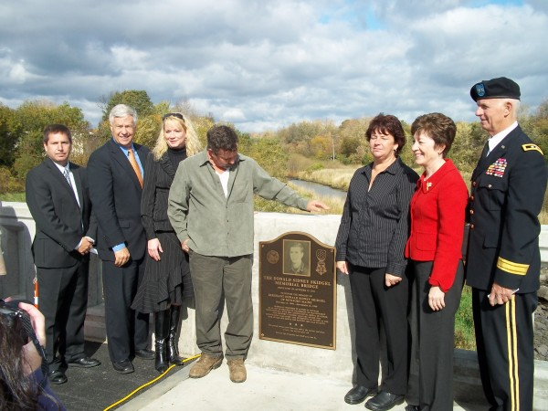 Donald Skidgel's children stand next to the newly placed plaque memorializing their father who received the Congressional Medal of Honor after dying in the Vietnam War. The Donald Sidney Skidgel Memorial Bridge was officially unveiled during a ceremony on the Sebasticook River in Newport on Saturday. In the photograph are State Rep. Kenneth Fredette (from left), U.S. Rep. Mike Michaud, Skidgel's children Mindy Martin, Terry Skidgel and Tammy Russell, U.S. Sen. Susan Collins and Gen. John Libby.