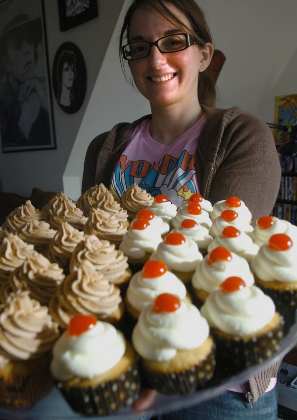Nicole King, a recent transplant to Bangor from Chicago, displays a tray of freshly made Butterfinger (left) and Pineapple Upside Down Cake (right) cupcakes, on Wednesday, October 12, 2011. King started Cherry Acres Bakery out of her apartment and keeps her fans updated on current flavors through Facebook and Twitter.