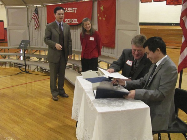 Keding Xia (right), principal of the Taishun Yucai School in coastal China, and RSU 12 Superintendent Gregory Potter sign a sister-school agreement between the Chinese school and Wiscasset High School on Friday, October 21, 2011. Wiscasset education officials are hoping to host Chinese students studying here in the coming years and perhaps send some American students to China. Looking on are Daniel Yu (left), a consultant who is working as a liaison, and Wiscasset High School Principal Deb Taylor.