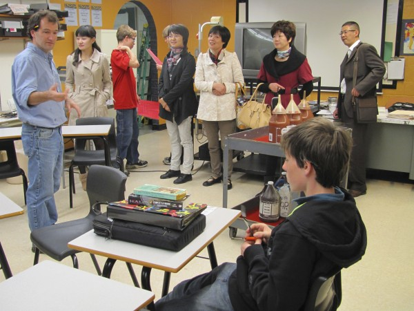 Wiscasset High School teacher Chip Schwehm greets a group of Chinese educators in his photography class on Friday, October 21, 2011. The Chinese educators were in Maine to explore the possibility of sending some students here to study.