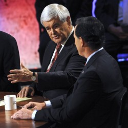 Republican presidential candidates former House Speaker Newt Gingrich speaks as former Pennsylvania Sen. Rick Santorum listens during a presidential debate at Dartmouth College in Hanover, N.H., earlier this month.