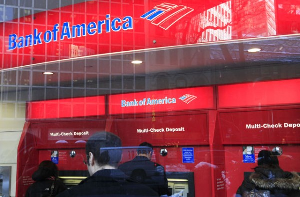 In this Jan. 31 photo, Bank of America customers use ATM machines in New York. When Bank of America starts charging customers a $5 monthly fee in 2012 to swipe their debit cards, the 38.7 million people who carry them will have to decide if the convenience is worth the money.