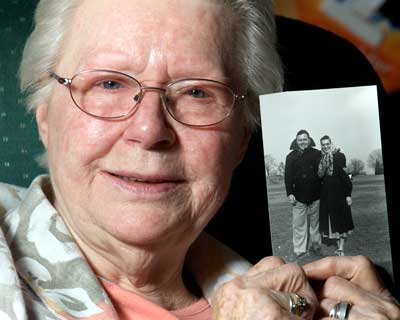 Doris Petre, 84, holds a picture of her brother, Richard Watrous, and his wife, Betty, taken in the 1950s. She hasn'€™t seen him in 80 years, but the siblings plan a face-to-face meeting in December.