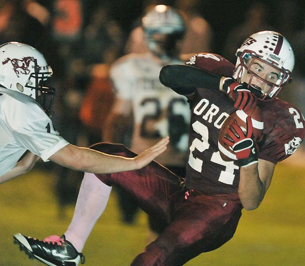 Orono's Tyler Higgins (24) comes down in the end zone with the ball on a pass reception in the second quarter of game against Foxcroft Academy in Orono Friday night, Sept. 30, 2011.