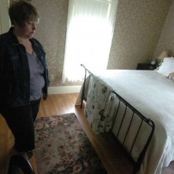 Bethany Foss, one of the family proprietors of the Chandler River Lodge in Jonesboro talks with the BDN about the several paranormal reports at the lodge, including a paranormal event in the Judah Chandler Room, where she is pictured.