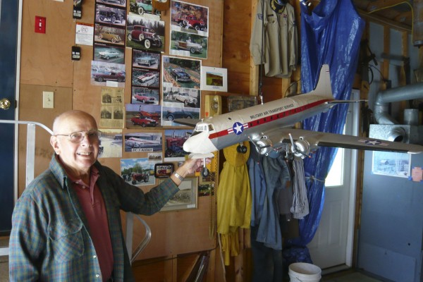 "Manley ""Joe"" Bailey of Lincolnville shows off his model of a DC-4 Airline-Freighter that took more than a year to build. Two other of Bailey's model aircraft are on display at the Thomaston Public Library."