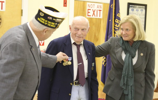 After waiting 65 years, Ben Harding, 93, of Thomaston was awarded several medals he earned for his service in WWII. Congresswoman Chellie Pingree (right) and First Vice Commander of American Legion district six Ronald Rainfrette (left) pin on Harding's (center) awards at a ceremony Thursday.