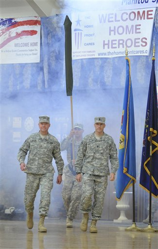 Command Major Gen. David Perkins, left, and Command Sgt. Major Daniel Dailey  lead in the soldiers of the 4th I.D. Headquarters during a homecoming ceremony  Friday, Oct. 21, 2011 at Ft. Carson, Colo.  All U.S. troops &quotwill definitely be home for the holidays,&quot President Barack Obama declared Friday.