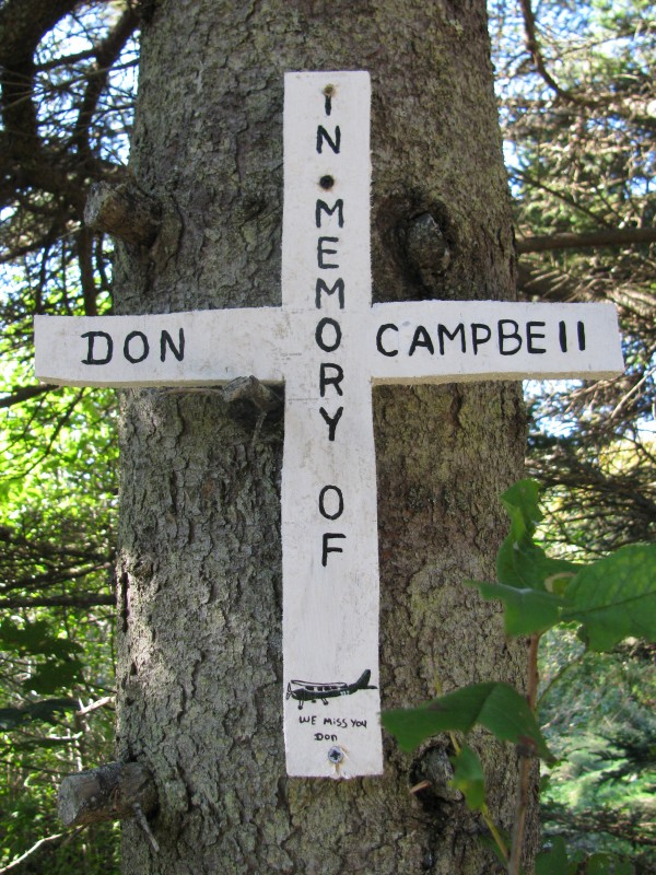 Islander Lacey Leigh made a wooden cross for Penobsot Island Air Pilot Don Campbell, hammering it into a spruce tree next to the site where his Cessna crashed Wednesday.