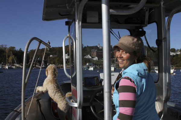 "Abbie Leonard, Rockport harbormaster does her job in her very special ""office space"" — her boat where her dog, Wilson, keeps watch."
