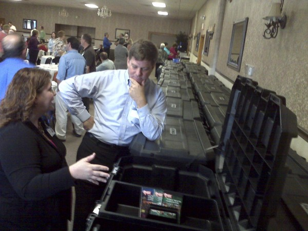 Allison Bankston (left), project manager of the Northeastern Maine Regional Resources Center's continuum of care operational preparedness and emergency response grant, shows Greg Urban of the Maine Veterans Home emergency operations center kits on Tuesday, Oct. 25, 2011. The kits, paid for by a federal grant, contain hand-crank radios, scanners and other useful emergency items.