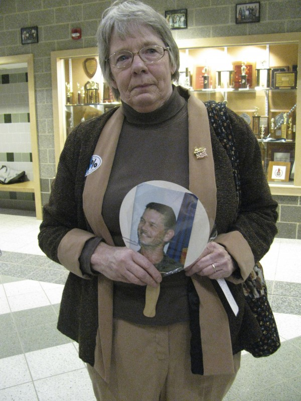 Catherine Burns of Skowhegan held up a photo Thursday night of her son, Sgt. Brett Pelotte, who died in 2003 while serving in the U.S. Army in South Korea. Burns attended Gov. Paul LePage's town hall event at Mount View High School, where she accused the governor of dodging the draft when he was a young man. &quotI don't like hypocrisy,&quot she said after leaving the auditorium.