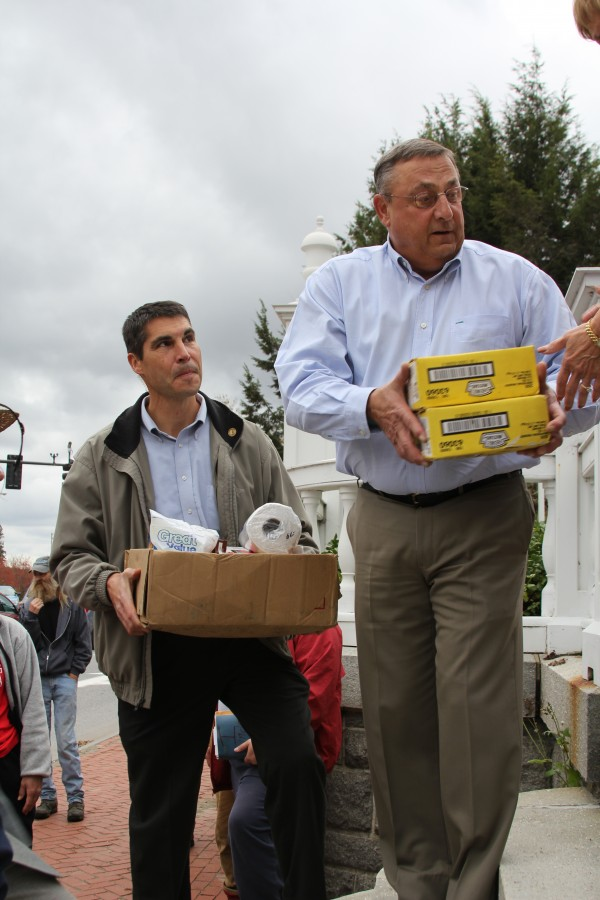 Executive Protection Unit Detective Gerald Coleman and Gov. Paul LePage help unload food donations at the Blaine House recently.