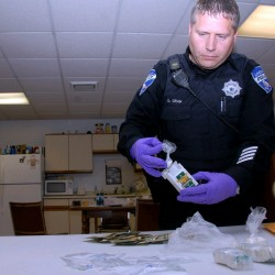 Officer David Cram displays on wednesday drugs police claim to have seized from a Connecticut man on tuesday Oct. 4, 2011.