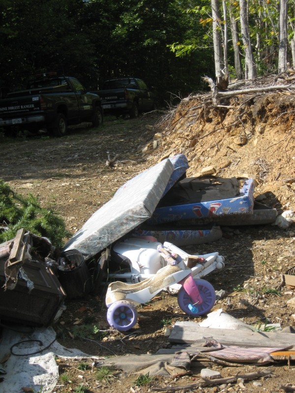"Illegal dump sites, such as the central Maine dump site shown here, are being targeted for clean up by the Maine Forest Service forest rangers on ""Landowner Appreciation Day,"" Oct. 15. Volunteers are being sought for the statewide event"