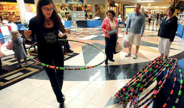 Kelley Tingley demonstrates one of her handcrafted hula hoops for shoppers at the Bangor Mall on Saturday. Tingley of Hardcore Hoops was among the 10 small businesses that were represented in the Maine Marketplace. The event was organized by Incubator Without Walls, a federally funded program that helps very small businesses.