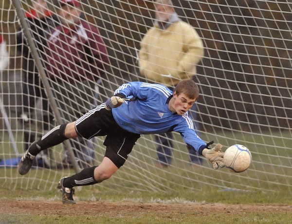 Bangor keeper Liam Harrigan can't stretch enough to block Messalonskee's second goal of their game in Bangor on Saturday Oct. 29, 2011.