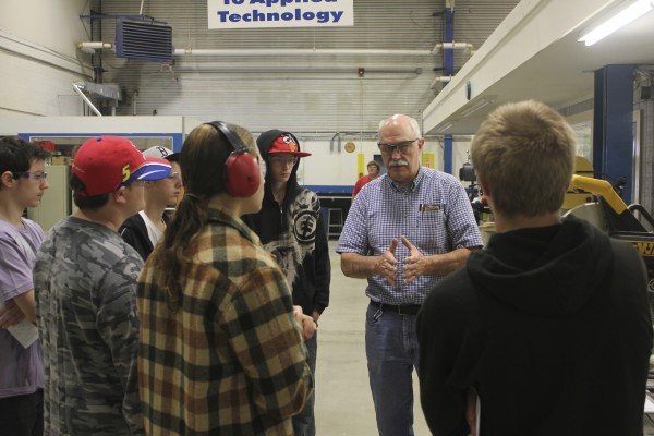 Clare Stinson (center), instructor of applied technology at Mid-Coast School of Technology in Rockland, discusses safety issues with students Dylan Richardson, Tanian Scattaloni, Stephen Spaulding, Richard Rich, Saxton Jones and Eddie VanDyke III.