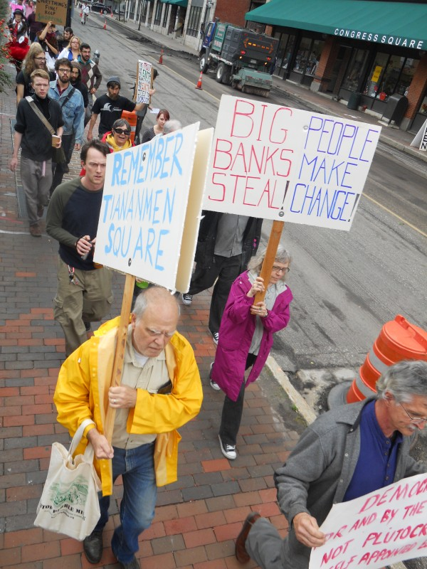 More than 60 people joined Occupy Maine as it held a march from Monument Square to the University of Southern Maine campus Monday afternoon.