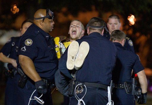 A protestor of the Occupy Atlanta demonstration is arrested after refusing to leave Woodruff Park early Wednesday.