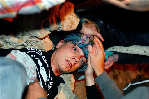 Iraq War veteran Scott Olsen lays on the ground bleeding after being struck by a by a projectile during an Occupy Wall Street protest in Oakland, Calif., on Tuesday.