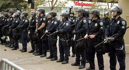 Oakland police officers in riot gear line Frank H. Ogawa plaza Tuesday, Oct. 25, 2011, in Oakland, Calif.