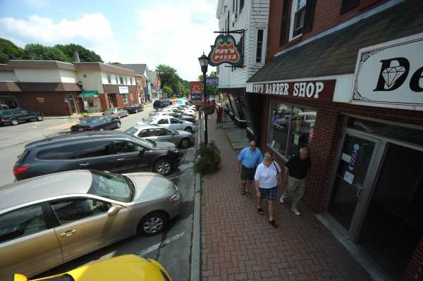 People walk on Mill Street in downtown Orono on Tuesday. NexxLinx, which purchased Microdyne Outsourcing, said it plans to add around 200 jobs at the Orono center by the end of the year.