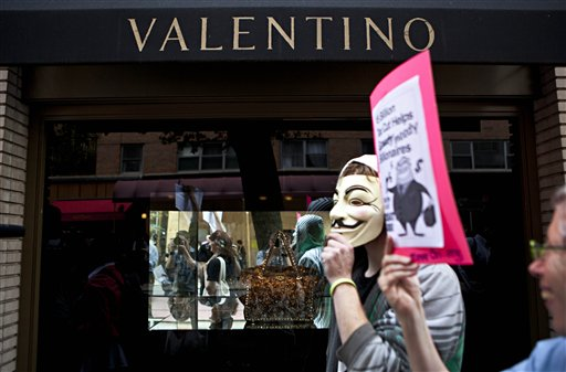 Protestors affiliated with the &quotOccupy Wall Street&quot protests march past a Valentino store on East 65th Street in New York, on Tuesday.
