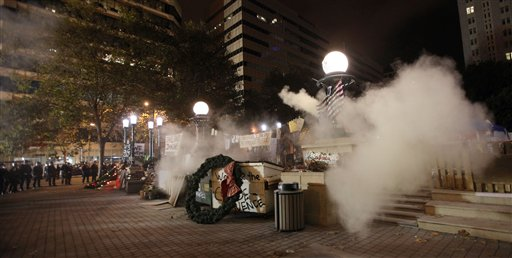 Oakland police fire tear gas as they prepare to move in to Frank Ogawa Plaza to disperse Occupy Oakland protesters on Tuesday.