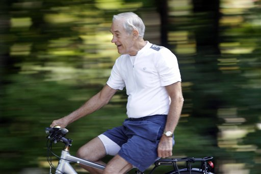 U.S. Rep. Ron Paul of Texas, breaks from campaigning for president to ride a bike in Concord, N.H.