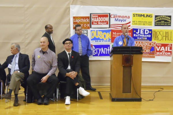 Portland mayoral candidate Markos Miller (at microphone) is one of 15 candidates to appear on the Nov. 8 ballot to become Portland's first popularly elected mayor in nearly 90 years. Also in the picture is (standing, from left to right) candidates Hamza Haadoow and Charles Bragdon, and (seated, from left to right) candidates Ralph Carmona, David Marshall and John Eder.