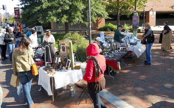 Artisans and craft makers sell products to tourists coming off of a cruise ship on Commercial Street Thursday. The city of Portland is planning to cement in an ordinance the difference between &quotart&quot and &quotcraft&quot as it works through the process of creating a weekly crafters market in Monument Square.