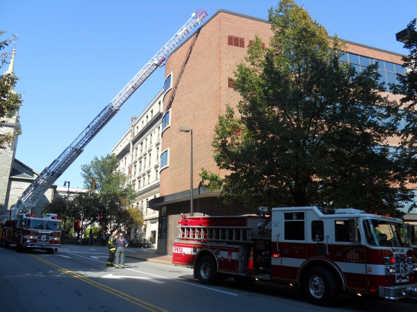 Portland fire trucks respond to a small elevator motor fire Monday at the Post Office Square building around noon.