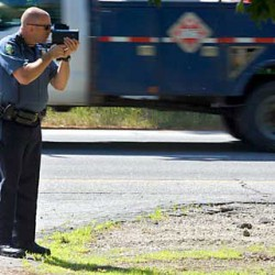 Brunswick Police Lt. Tom Garrepy uses a radar gun to check vehicle speeds on Route 1 in July 2011.