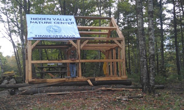 "Hidden Valley Nature Center in Jefferson is conducting a raffle to raise funds to complete its new welcoming center. Recently, timber framing students completed the ""bones"" of the new structure."