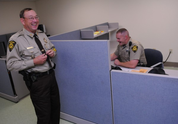 Penobscot Sheriff Glen Ross and deputy sheriff Seam McCue share a laugh in the new patrolmens area in the former Penobscot courthouse in Bangor on Friday, October 21, 2011.