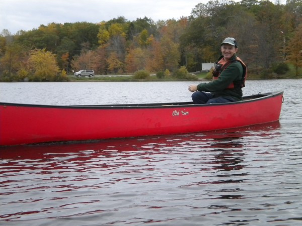 Robert Causey gets his red Old Town Scout canoe under way at Pushaw Lake's Gould Landing on his birthday outing last Wednesday.