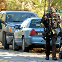 Law enforcement officials from Maine State Police and the Penobscot County Sheriff's Office respond to a domestic disturbance call involving a gun Wednesday morning on Holiday Lane off Route 155 in Enfield.